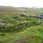 Ruins of blackhouse beyond the Mealista farm boundary wall