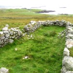 Ruins of blackhouse beyond the farm boundary wall